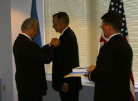 President Arnold Rüütel handed over the Order of the Cross of Terra Mariana to George Bush